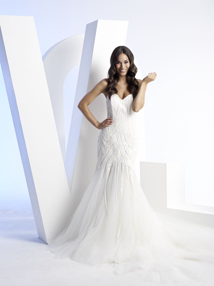 Gown by Amarige Bridal 02 8068 0862 / amarigebridal.com.au Jewellery by Claire Aristides