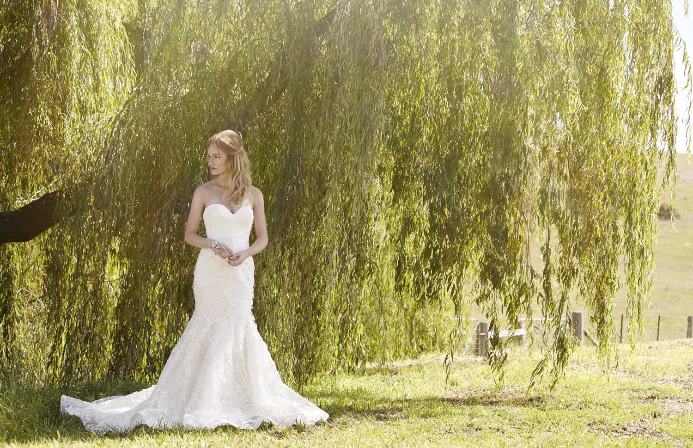 Gown by Rosalynn Win 02 8209 1739 / rosalynnwin.com Jewellery by House of Emmanuel